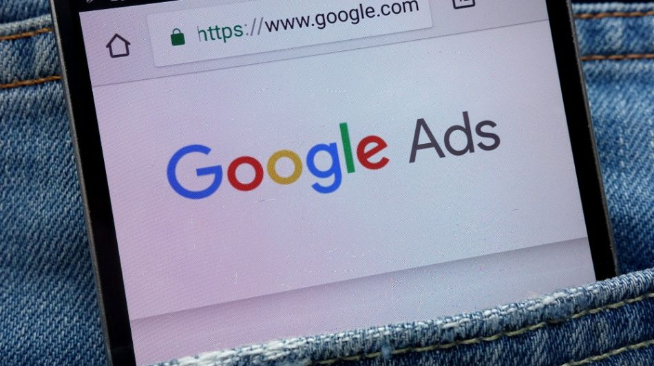 Google Ads website displayed on smartphone hidden in jeans pocket - The Ad Firm